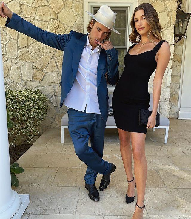 """<p>The Bieber's got all dressed up to attend a wedding over the weekend. </p><p>The singer opted for a dapper blue suit and a white hat while the model went full sleek wedding date in a chic LBD that gave further confirmation that the bandeau dress is officially back.</p><p>The cool photo appears to have gone down well with fans as a humble five million plus people gave it a 'like' on Instagram. </p><p><a href=""""https://www.instagram.com/p/CN0yvn2HIKk/"""" rel=""""nofollow noopener"""" target=""""_blank"""" data-ylk=""""slk:See the original post on Instagram"""" class=""""link rapid-noclick-resp"""">See the original post on Instagram</a></p>"""