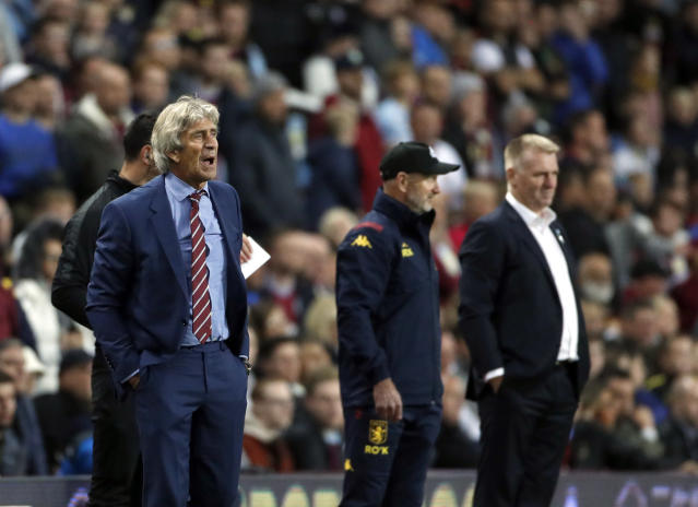 West Ham's manager Manuel Pellegrini, left, reacts during their English Premier League soccer match between Aston Villa and West Ham United at Villa Park in Birmingham, England, Monday, Sept. 16, 2019. (AP Photo/Rui Vieira)