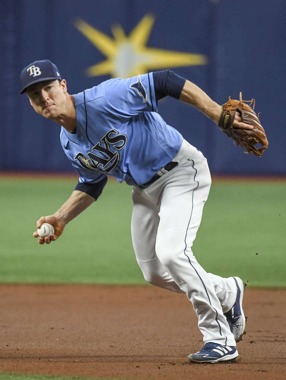Tampa Bay Rays infielder Joey Wendle barehands an infield single hit by Toronto Blue Jays' Teoscar Hernandez during the first inning of a baseball game Friday, July 9, 2021, in St. Petersburg, Fla.(AP Photo/Steve Nesius)
