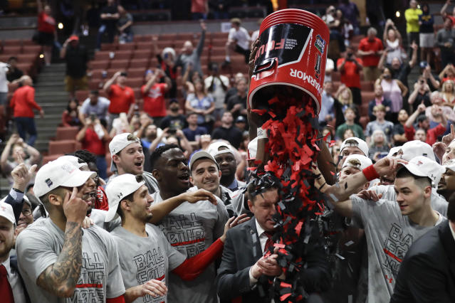 Texas Tech players shower coach Chris Beard with confetti after their win against Gonzaga during the West Regional final in the NCAA men's college basketball tournament Saturday, March 30, 2019, in Anaheim, Calif. Texas Tech won 75-69. (AP Photo/Marcio Jose Sanchez)