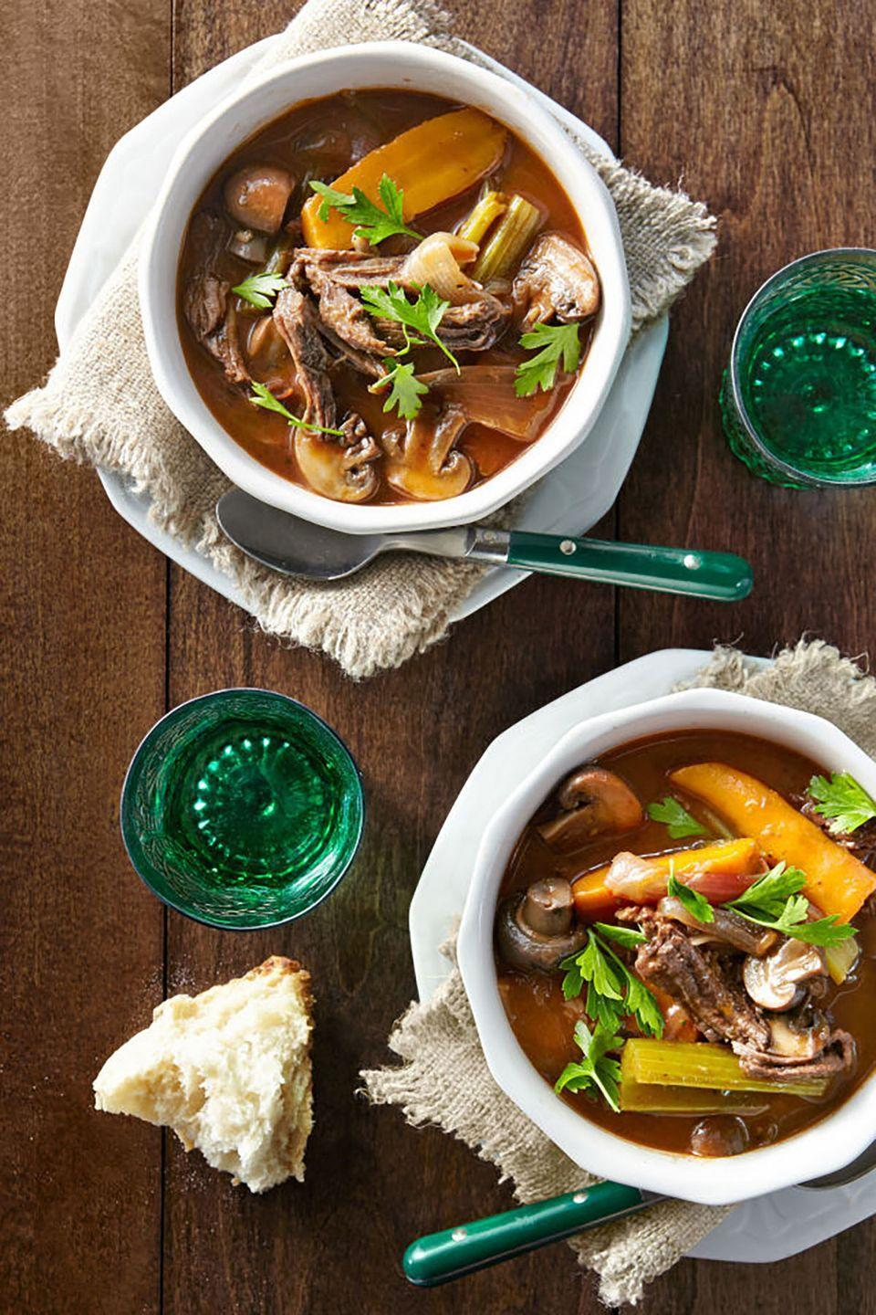 """<p>This savory, protein-packed dish is perfect for a romantic meal at home, especially on a chilly winter evening. Simple and quick to throw together, the stew can cook all day so it's ready when you and your sweetheart are.</p><p><strong><a href=""""https://www.countryliving.com/food-drinks/recipes/a41065/slow-cooker-red-wine-beef-stew/"""" rel=""""nofollow noopener"""" target=""""_blank"""" data-ylk=""""slk:Get the recipe"""" class=""""link rapid-noclick-resp"""">Get the recipe</a>.</strong><br></p><p><a class=""""link rapid-noclick-resp"""" href=""""https://www.amazon.com/Crock-Pot-SCV700SS-Stainless-7-Quart-Manual/dp/B003OAJGJO/?tag=syn-yahoo-20&ascsubtag=%5Bartid%7C10050.g.1115%5Bsrc%7Cyahoo-us"""" rel=""""nofollow noopener"""" target=""""_blank"""" data-ylk=""""slk:SHOP SLOW COOKERS"""">SHOP SLOW COOKERS</a> </p>"""