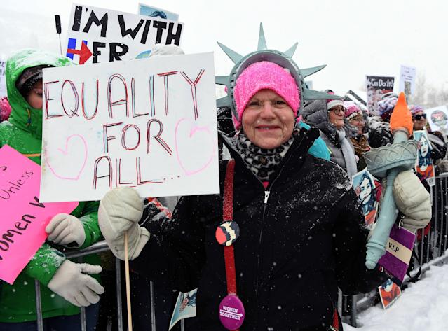 <p>A participant attends Respect Rally Park City to celebrate community victories, honoring the one-year anniversary of the Women's March and Park City's March on Main on Jan. 20, 2018 in Park City, Utah. (Photo: Angela Weiss /AFP/Getty Images) </p>