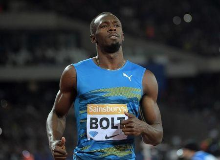 Usain Bolt (JAM) wins the 100m in 9.87 during the 2015 Sainsbury's Anniversary Games at Olympic Stadium at Queen Elizabeth Olympic Park. Kirby Lee-USA TODAY Sports