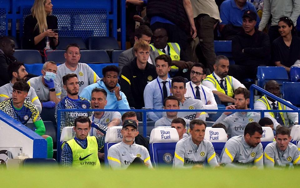 Chelsea manager Thomas Tuchel (front second left) and Ben Chilwell (front left) on the bench during the Premier League match at Stamford Bridge, London. - PA