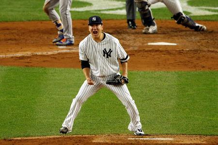 Oct 18, 2017; Bronx, NY, USA; New York Yankees starting pitcher Masahiro Tanaka (19) reacts after pitching during the fifth inning against the Houston Astros in game five of the 2017 ALCS playoff baseball series at Yankee Stadium. Mandatory Credit: Adam Hunger-USA TODAY Sports