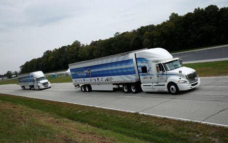 "Two trucks demonstrate ""platooning"" technology at the Navistar Proving Grounds in New Carlisle, Indiana, U.S., October 12, 2016. REUTERS/Jim Young"