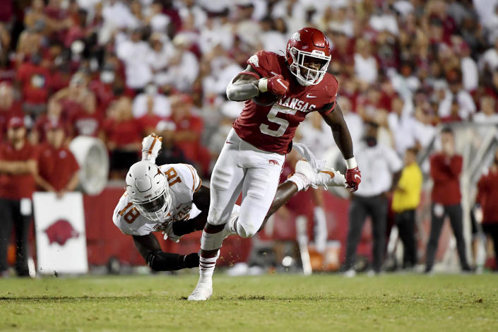 Arkansas running back Raheim Sanders (5) sheds Texas defender Ovie Oghoufo (18) as he runs for a touchdown during the second half of an NCAA college football game Saturday, Sept. 11, 2021, in Fayetteville, Ark. (AP Photo/Michael Woods)