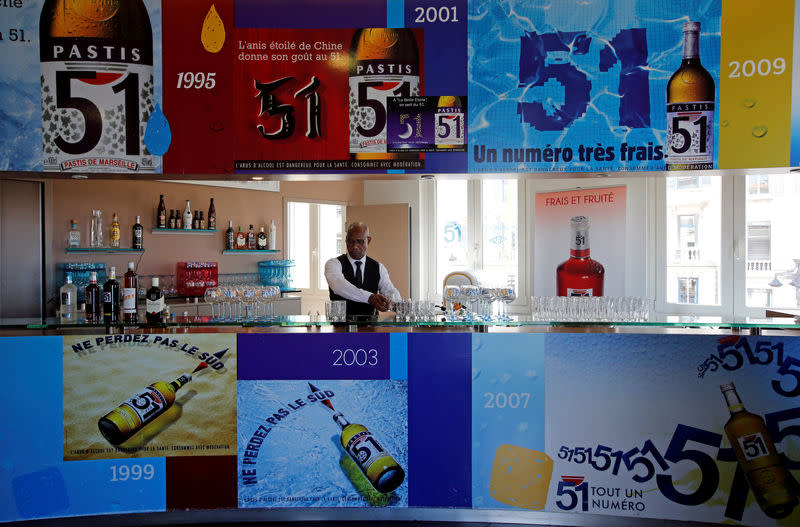 """FILE PHOTO: A barman of French drinks maker Pernod Ricard group prepares drinks for clients at the """" Club Pernod"""" in Marseille"""