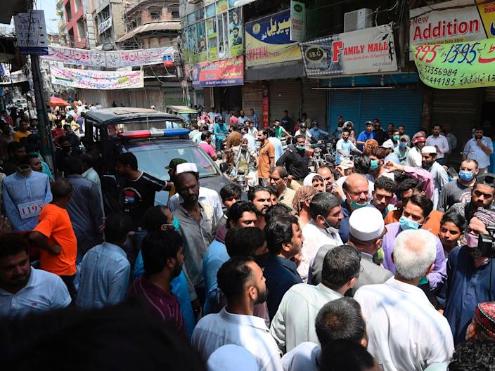 """Traders protest beside their closed shops against a lockdown imposed by the Punjab provincial government ahead of the Muslim festival Eid al-Adha or the 'Festival of Sacrifice', in Lahore on July 28, 2020. <p class=""""copyright"""">ARIF ALI/AFP via Getty Images</p>"""