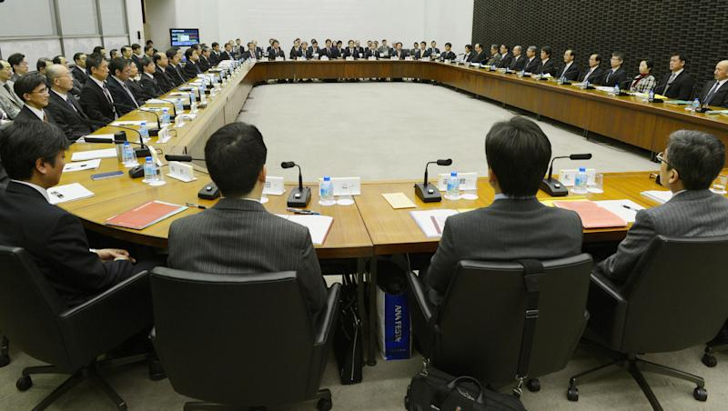 Bank of Japan Gov. Masaaki Shirakawa, sixth from the bottom at right side, prepares to attend a meeting with branch managers at its headquarters in Tokyo Tuesday, Jan. 15. 2013. The governor of Japan's central bank says it will persist in easing monetary conditions as it tries to pull the country out of a deflationary slump. (AP Photo/Kyodo News) JAPAN OUT, MANDATORY CREDIT, NO LICENSING IN CHINA, HONG KONG, JAPAN, SOUTH KOREA AND FRANCE