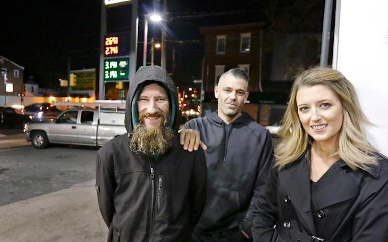 Johnny Bobbitt Jr., left, Kate McClure, right, and McClure's boyfriend Mark D'Amico. The homeless veteran spent his last £15 to help the stranded motorist  - The Philadelphia Inquirer