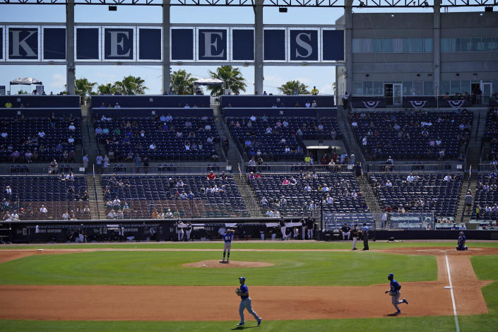 The Toronto Blue Jays take the field during a spring training exhibition baseball game, with a limited number of fans, socially distanced in attendance, against the New York Yankees at George M. Steinbrenner Field in Tampa, Fla., Saturday, March 27, 2021. (AP Photo/Gene J. Puskar)