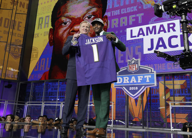 Roger Goodell, left, presents Lamar Jackson with his Baltimore Ravens jersey during the 2018 NFL football draft. Jackson was the last player taken in the first round. (AP)