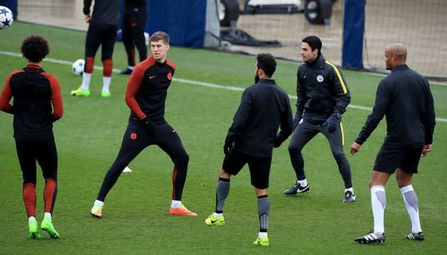 Manchester City's John Stones, second left and his former coach Arteta, second right, worked together for years (Peter Byrne/PA)