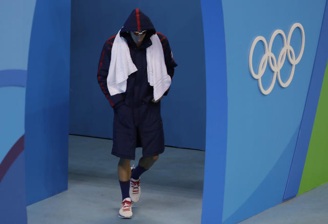 FILE - In this Aug. 11, 2016, file photo, United States' Michael Phelps arrives to compete in the final of the men's 200-meter individual medley during the swimming competitions at the 2016 Summer Olympics, in Rio de Janeiro, Brazil. After revealing the depths of his depression _ and even thoughts of suicide after his second drunken-driving arrest _ Phelps is hoping to make a difference for those who are dealing with similar issues. The 23-time Olympic gold medalist announced a partnership with Talkspace, which provides online therapy, and said he considers it a higher calling than anything he ever did as a swimmer. (AP Photo/Natacha Pisarenko, FIle)
