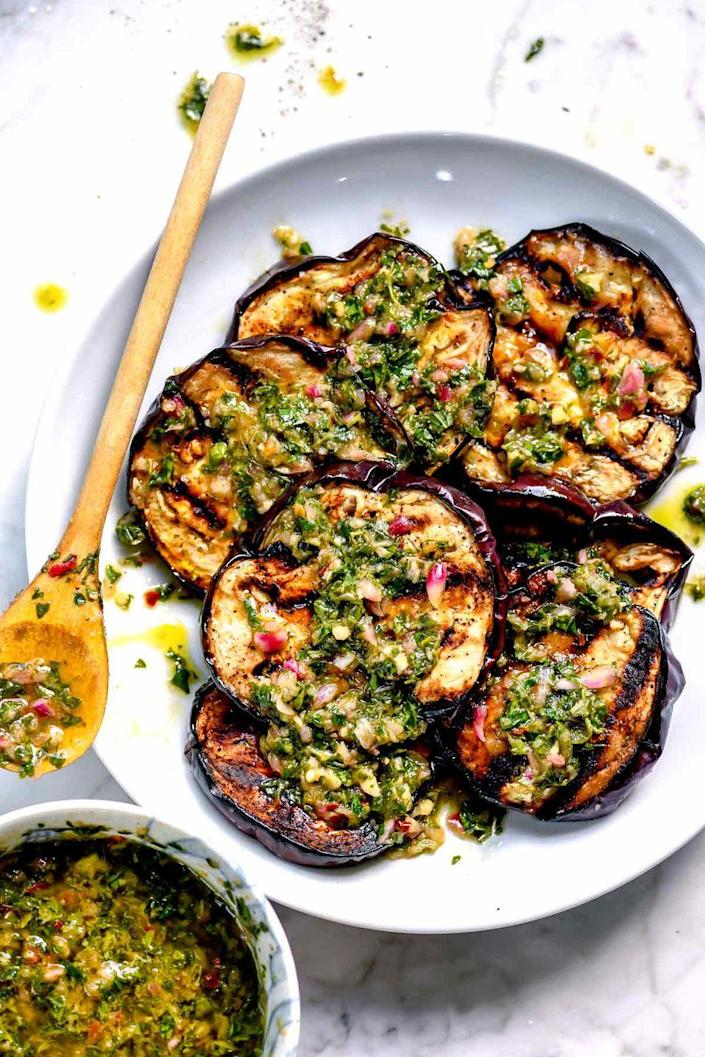 """<p>In the summertime, grilling eggplant gives them a smoky flavor that pairs so well with the fresh herbs of chimichurri. To prevent limp or mushy eggplant, cut them in uniform slices about ½-inch thick. </p><p><strong>Get the recipe at <a href=""""https://www.foodiecrush.com/grilled-eggplant/"""" rel=""""nofollow noopener"""" target=""""_blank"""" data-ylk=""""slk:Foodie Crush"""" class=""""link rapid-noclick-resp"""">Foodie Crush</a>. </strong></p><p><a class=""""link rapid-noclick-resp"""" href=""""https://go.redirectingat.com?id=74968X1596630&url=https%3A%2F%2Fwww.walmart.com%2Fsearch%2F%3Fquery%3Dfood%2Bprocessor&sref=https%3A%2F%2Fwww.thepioneerwoman.com%2Ffood-cooking%2Fmeals-menus%2Fg36353420%2Ffourth-of-july-side-dishes%2F"""" rel=""""nofollow noopener"""" target=""""_blank"""" data-ylk=""""slk:SHOP FOOD PROCESSORS"""">SHOP FOOD PROCESSORS</a></p>"""