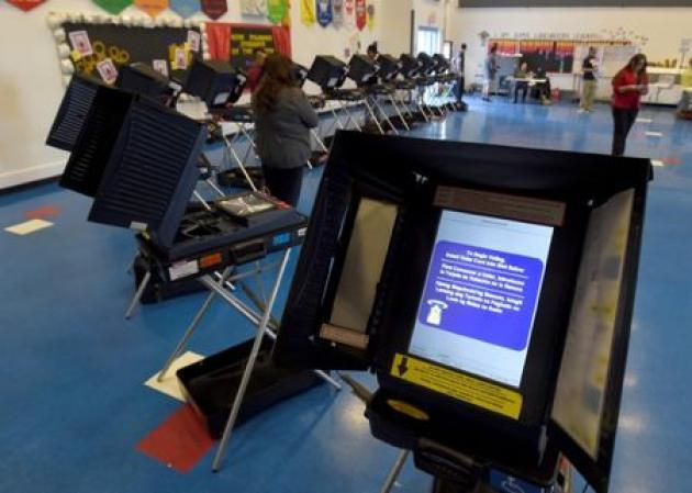 Hackers scour voting machines for election bugs