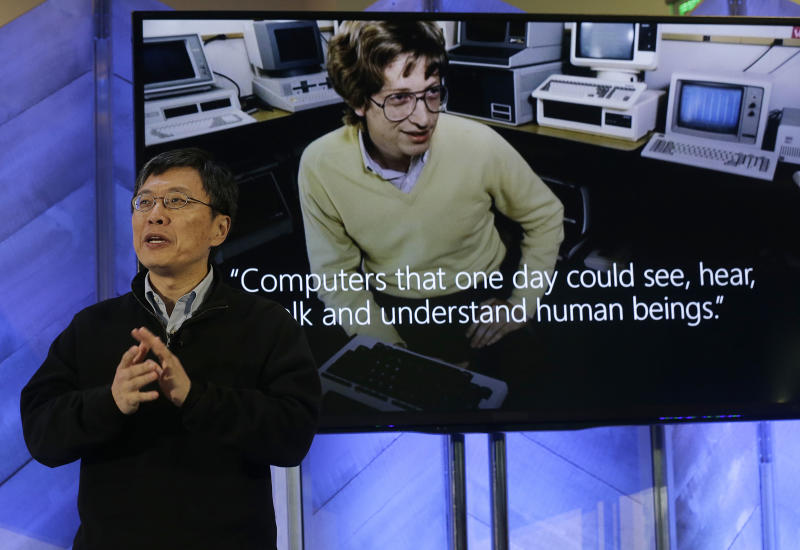 Harry Shum,executive vice president ofMicrosoft'sArtificial Intelligence and Research, speaks at a Microsoft event in San Francisco, Wednesday, Dec. 13, 2017. Microsoft rolled out new features on its Bing search engine powered by artificial intelligence, including one that summarizes the two opposing sides of contentious questions, and another that measures how many reputable sources are behind a given answer. (AP Photo/Jeff Chiu)