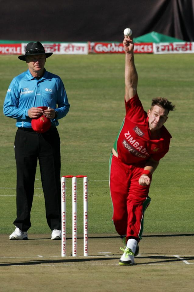 Zimbabwe's Kyle Jarvis bowls during the 2nd match of the 5 match cricket ODI series between hosts Zimbabwe and India at Harare Sports Club on July 26, 2013. AFP PHOTO /Jekesai Njikizana.        (Photo credit should read JEKESAI NJIKIZANA/AFP/Getty Images)