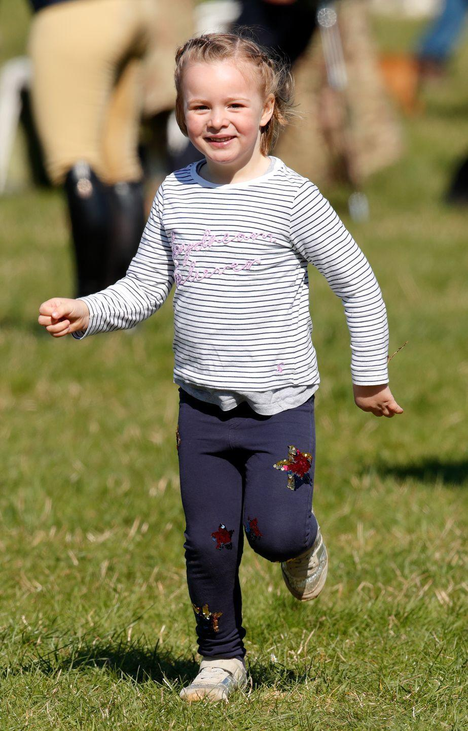 """<p><strong>Branch of the Family Tree: </strong>Daughter of Zara Tindall; great-granddaughter of Queen Elizabeth II</p><p><strong>More: </strong><a href=""""https://www.townandcountrymag.com/society/tradition/a15158722/mia-tindall-facts/"""" rel=""""nofollow noopener"""" target=""""_blank"""" data-ylk=""""slk:Meet the Queen's Great-Granddaughter Mia Tindall"""" class=""""link rapid-noclick-resp"""">Meet the Queen's Great-Granddaughter Mia Tindall </a></p>"""