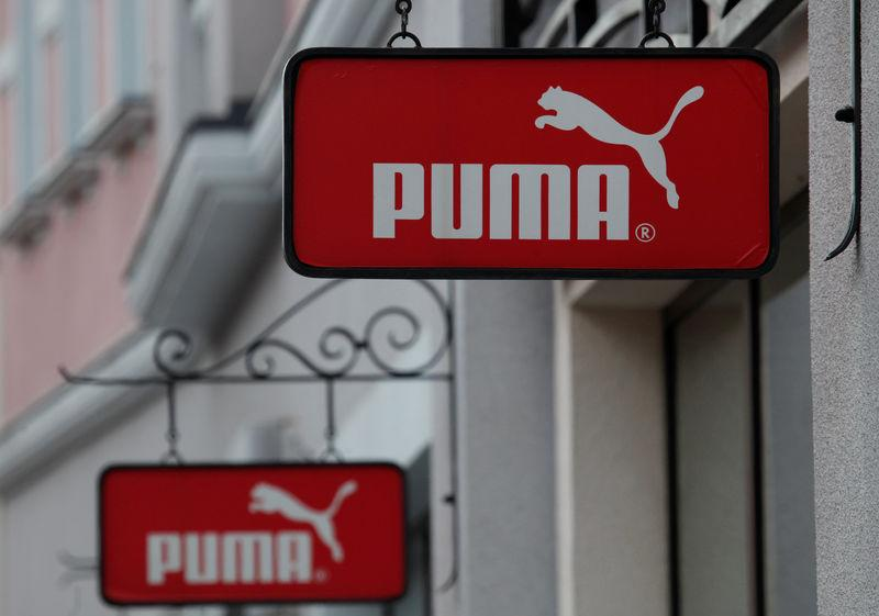 FILE PHOTO: Boards with Puma store logo are seen on a shopping center at the outlet village Belaya Dacha outside Moscow