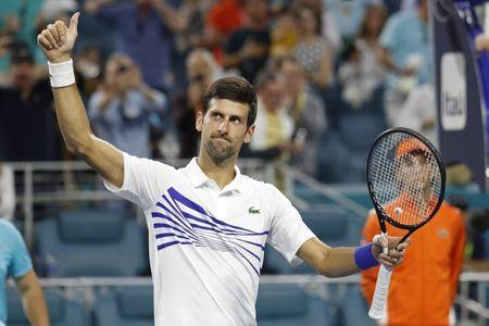 Mar 24, 2019; Miami Gardens, FL, USA; Novak Djokovic of Serbia salutes the crowd after his match against Federico Delbonis of Argentina (not pictured) in the third round of the Miami Open at Miami Open Tennis Complex. Mandatory Credit: Geoff Burke-USA TODAY Sports