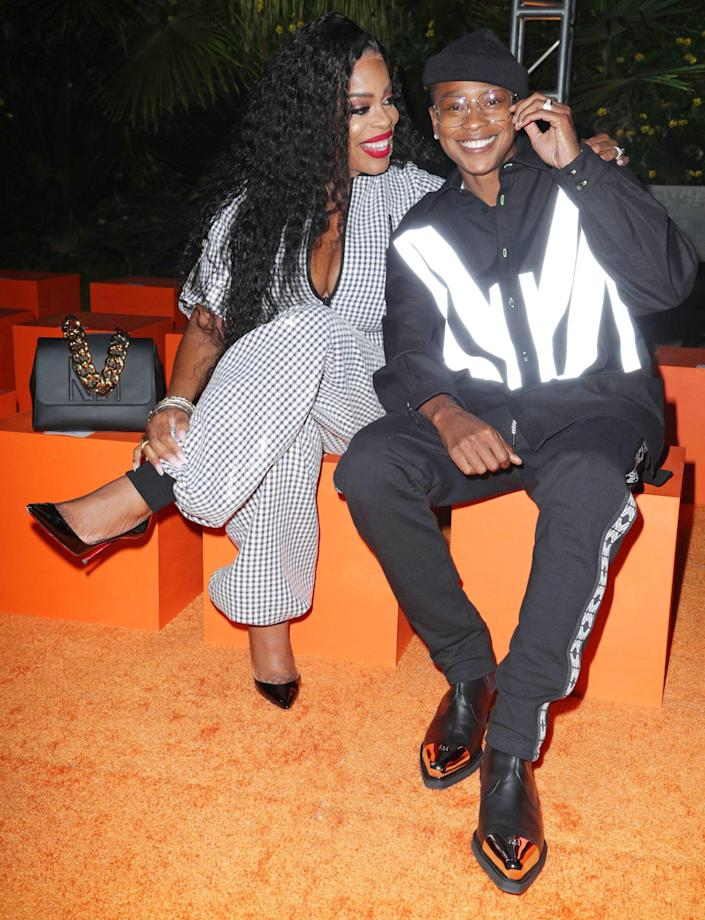 <p>Niecy Nash and wife Jessica Betts are one cute, coordinated couple on Sept. 16 at the Marcell Von Berlin runway show in Los Angeles. </p>