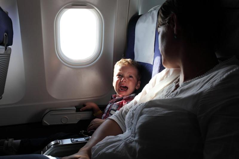 It takes kids 49 minutes to get bored on a flight. Photo: Getty Images