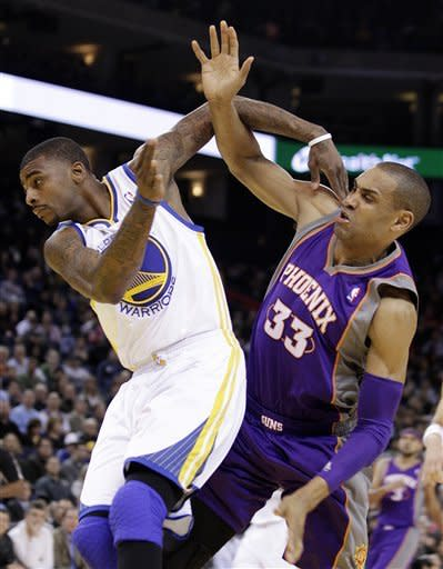 Phoenix Suns' Grant Hill (33) and Golden State Warriors' Dorell Wright fight for a rebound during the first half of an NBA basketball game, Monday, Feb. 13, 2012, in Oakland, Calif. (AP Photo/Ben Margot)