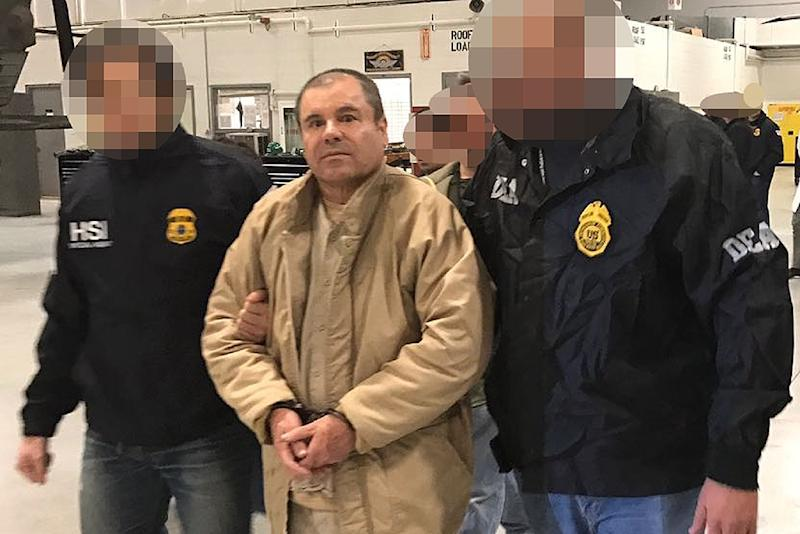 "Joaquin ""El Chapo"" Guzman (C) is escorted by Mexican police in the border city of Ciudad Juarez as he is extradited to the United States in January 2017 (AFP Photo/HO)"