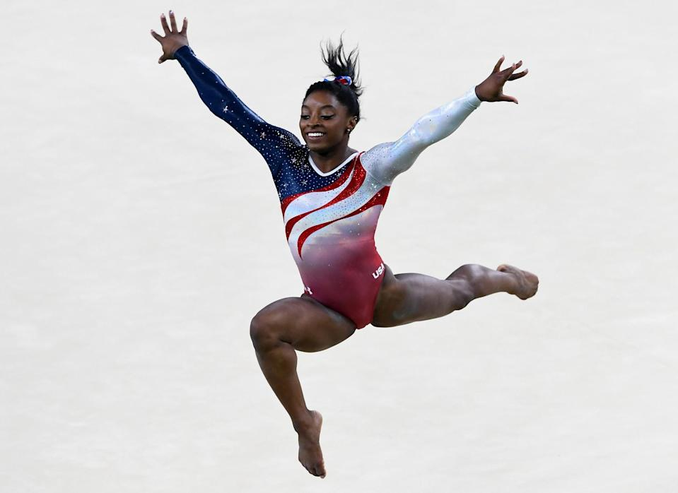 <p>Simone Biles of the United States competes on the floor during the Artistic Gymnastics Women's Team Final on Day 4 of the Rio 2016 Olympic Games at the Rio Olympic Arena on August 9, 2016 in Rio de Janeiro, Brazil. (Photo by Quinn Rooney/Getty Images) </p>