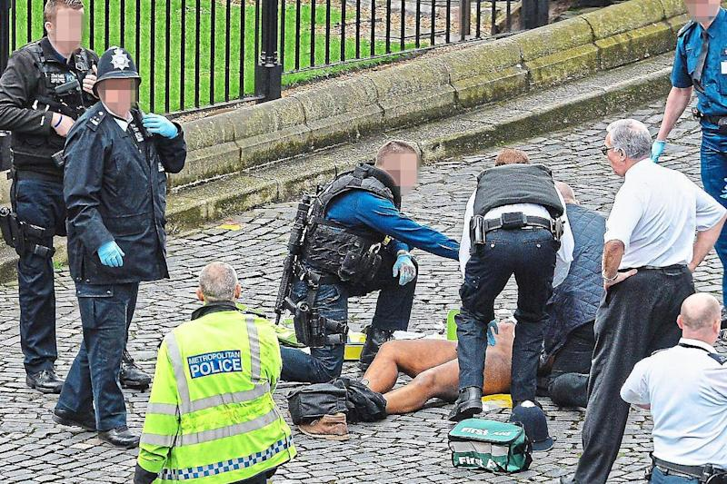 Specialist firearms officers battling to save terrorist Khalid Masood after he stabbed Pc Keith Palmer to death: Stefan Rousseau/PA Wire