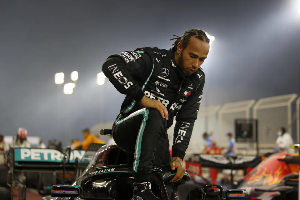 FILE - In this Sunday, Nov. 29, 2020 file photo Mercedes driver Lewis Hamilton of Britain exits his car after wining the Formula One race in Bahrain International Circuit in Sakhir, Bahrain. World champion Lewis Hamilton tested positive for COVID-19 and will miss the Sakhir Grand Prix this weekend, his Mercedes-AMG Petronas F1 Team said Tuesday Dec. 1, 2020. (Hamad Mohammed, Pool via AP, File)