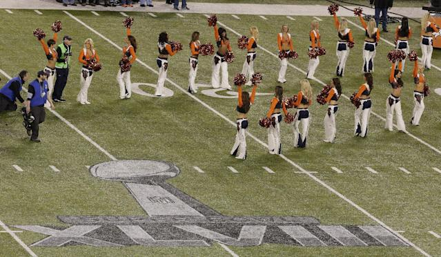 Denver Broncos cheerleaders enter the MetLife Stadium before the NFL Super Bowl XLVIII football game against the Seattle Seahawks Sunday, Feb. 2, 2014, in East Rutherford, N.J. (AP Photo/Charlie Riedel)