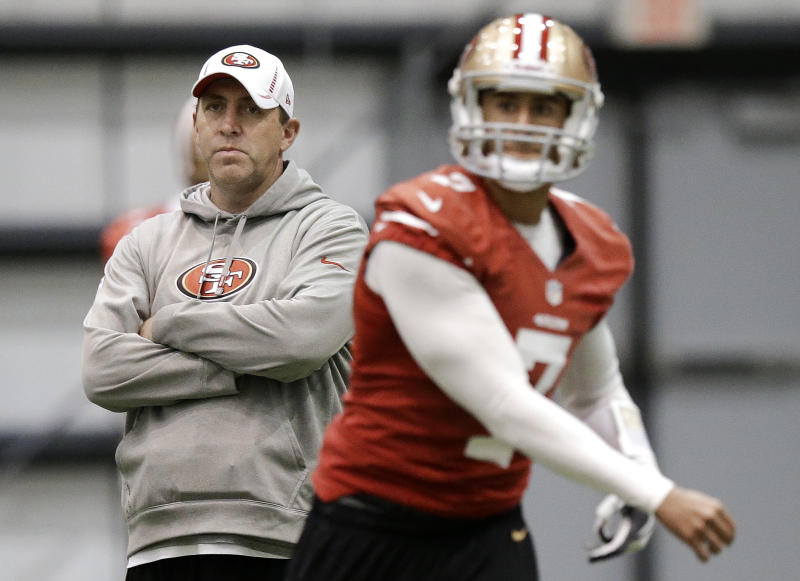 San Francisco 49ers quarterbacks coach Geep Chryst, left, watches as Colin Kaepernick (7) passes during practice on Wednesday, Jan. 30, 2013, in New Orleans. The 49ers are scheduled to play the Baltimore Ravens in the NFL Super Bowl XLVII football game on Feb. 3. (AP Photo/Mark Humphrey)