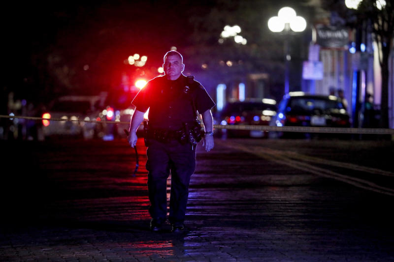 Authorities work at the scene of a mass shooting, Sunday, Aug. 4, 2019, in Dayton, Ohio. Several people in Ohio have been killed in the second mass shooting in the U.S. in less than 24 hours, and the suspected shooter is also deceased, police said. (Photo: John Minchillo/AP)