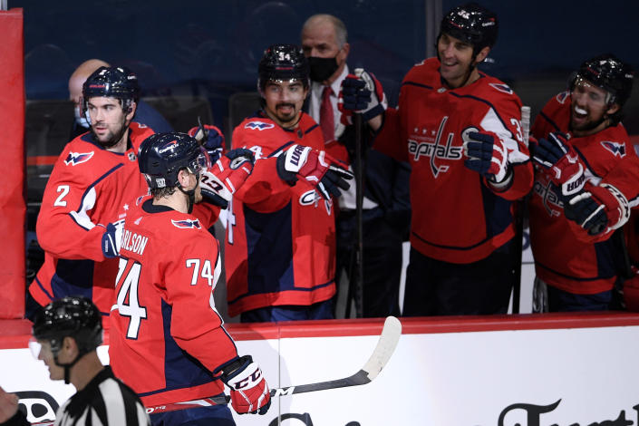 Washington Capitals defenseman John Carlson (74) celebrates his goal during the shootout of an NHL hockey game against the Buffalo Sabres, Friday, Jan. 22, 2021, in Washington. (AP Photo/Nick Wass)