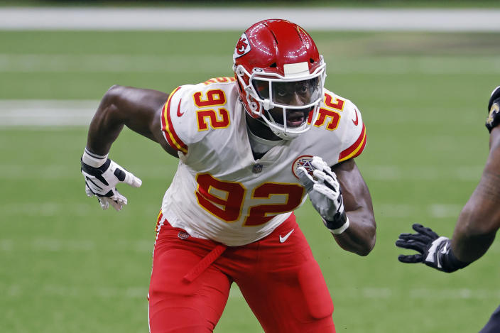 FILE - In this Dec. 20, 2020, file photo, Kansas City Chiefs defensive end Tanoh Kpassagnon (92) rushes during an NFL football game against the New Orleans Saints in New Orleans. Kpassagnon grew up in a home where excellent grades and academic achievements were not only encouraged, they were expected. That's what happens when your mother is a chemist and father an economist, both with doctoral degrees. The bar is set incredibly high. (AP Photo/Tyler Kaufman, File)