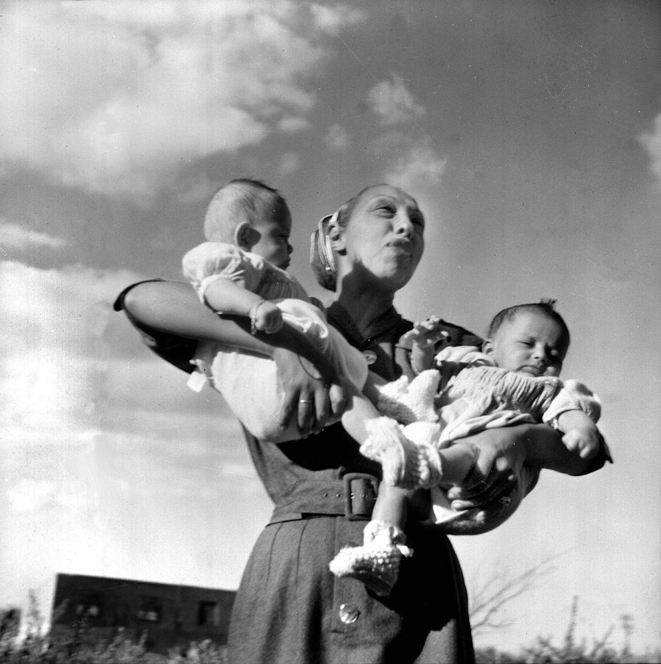 """<p>In 1950, Baker and Bouillon adopted two children together, sons from Asia. They ended up adopting 12 children, from places all around the world. Baker <a href=""""https://www.biography.com/performer/josephine-baker"""" rel=""""nofollow noopener"""" target=""""_blank"""" data-ylk=""""slk:dubbed their brood the &quot;Rainbow Tribe&quot;"""" class=""""link rapid-noclick-resp"""">dubbed their brood the """"Rainbow Tribe""""</a> and used their co-habitation as a form of social activism, proving it was possible for various races to live as brothers and sisters in peace.</p>"""
