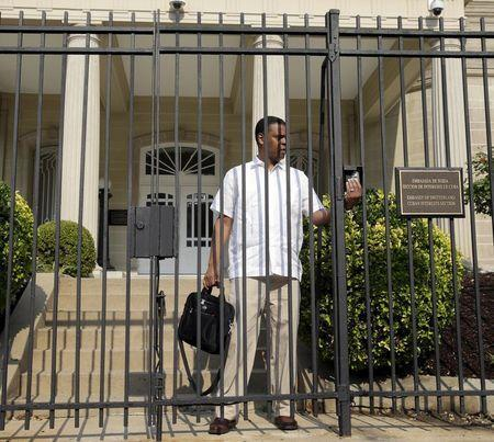 A man leaves the Cuban Interests Section in Washington, July 1, 2015. REUTERS/Gary Cameron