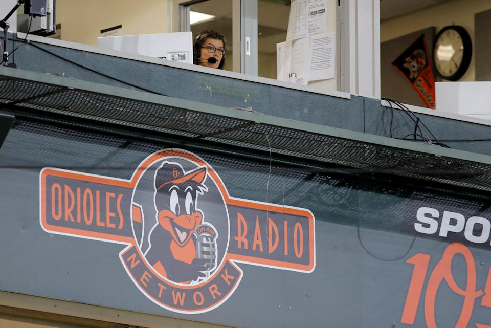 Baltimore Orioles broadcaster Melanie Newman is seen in the booth during the eighth inning of a baseball game between the Orioles and the Miami Marlins, Tuesday, Aug. 4, 2020, in Baltimore. With the broadcast, Newman became the first female broadcaster in Orioles franchise history to call play-by-play for a regular season game. (AP Photo/Julio Cortez)