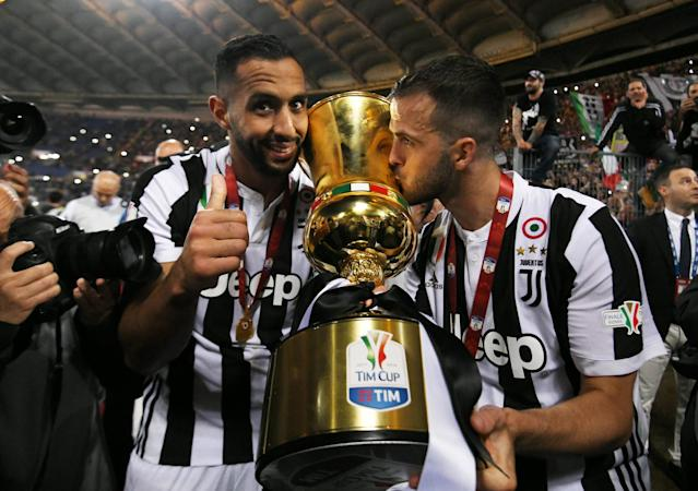 Soccer Football - Coppa Italia Final - Juventus vs AC Milan - Stadio Olimpico, Rome, Italy - May 9, 2018 Juventus' Medhi Benatia and Miralem Pjanic celebrate with the trophy after winning the Coppa Italia REUTERS/Alberto Lingria