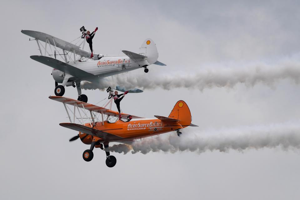 BOURNEMOUTH, ENGLAND - SEPTEMBER 02: AeroSuperBatics Wingwalkers perform during the Bournemouth Air Festival on September 02, 2021 in Bournemouth, England. The air show runs from the 02nd to 05th September and features numerous displays including a performances by the RAFAT Red Arrows, RAF Typhoon, Chinook and full Battle of Britain memorial flight. (Photo by Finnbarr Webster/Getty Images)