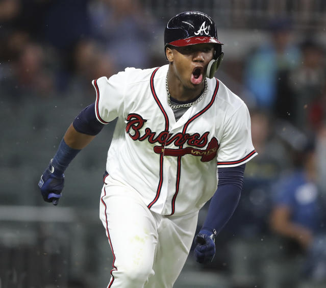 Atlanta Braves' Ronald Acuna Jr. reacts to hitting an RBI single during the eighth inning against the Chicago Cubs in a baseball game Wednesday, May 16, 2018, in Atlanta. The Braves scored three runs in the inning on the way to a 4-1 win. (Curtis Compton/Atlanta Journal-Constitution via AP)