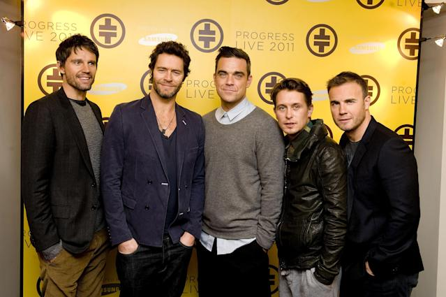 Jason Orange, Howard Donald, Robbie Williams, Mark Owen and Gary Barlow of Take That pictured back in 2010 (PA)
