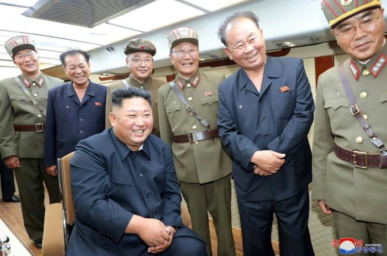 Kim observed the test surrounded by his aides (AFP Photo/KCNA VIA KNS)