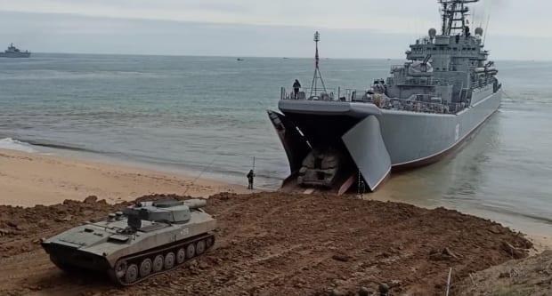 A Russian landing ship in the Black Sea rehearses an amphibious invasion on a beach in occupied Crimea.