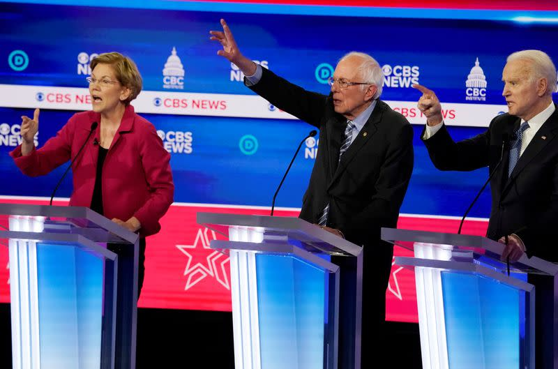 FILE PHOTO: Candidates discuss an issue during the tenth Democratic 2020 presidential debate at the Gaillard Center in Charleston, South Carolina, U.S.