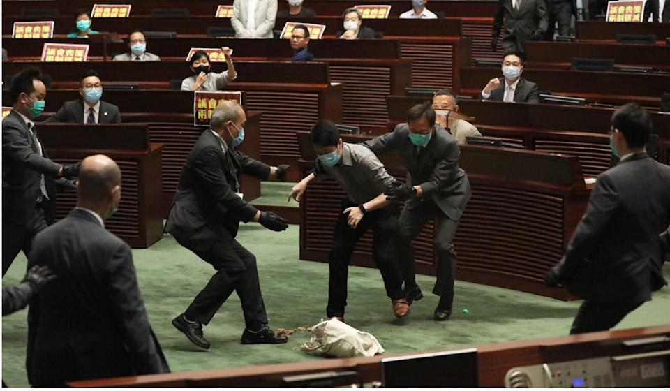 Legco staff grab Ted Hui in the chamber on May 28. Photo: Nora Tam