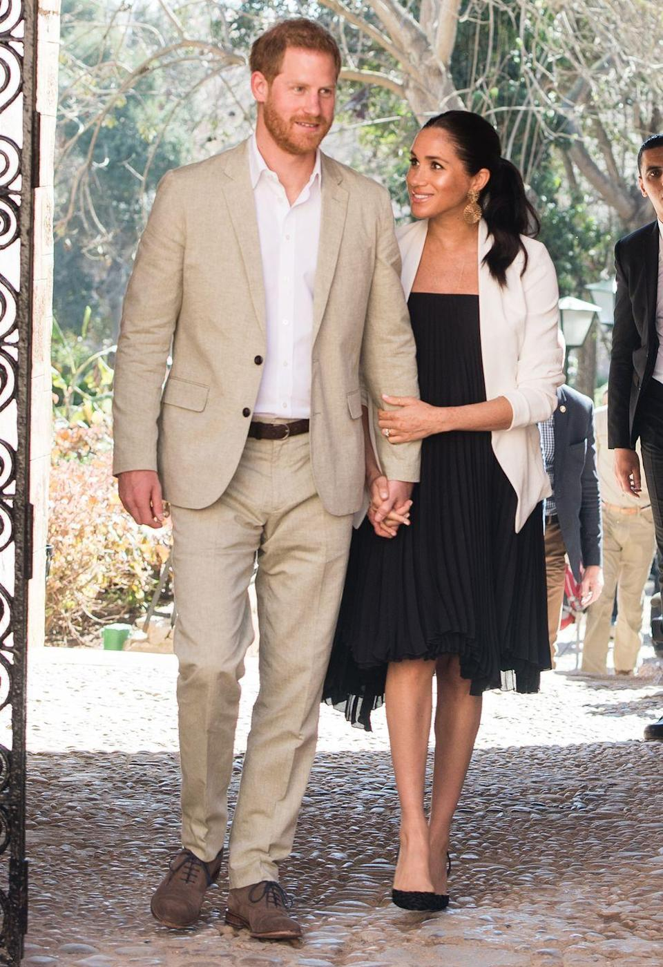 <p>Meghan gazes up at Harry as they visit the Andalusian Gardens in Rabat, Morocco. </p>